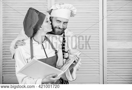 Helpful Culinary Book. Woman Chef And Man Cooking Food Together. Culinary Family Concept. Couple In