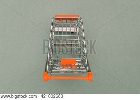 Supermarket Grocery Cart Isolated On Green Background. Trade, Business And Sales Concept. Electronic