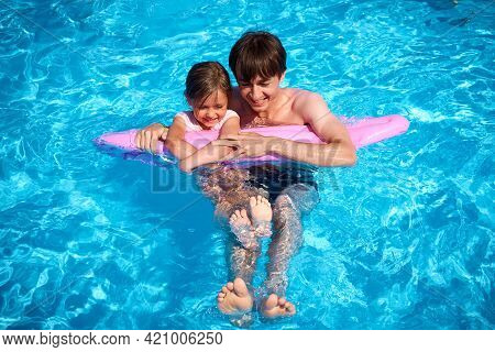 Dad And Daughter Are Having Fun In The Pool. Family Summer Vacation In The Pool. A Happy Family. Sum