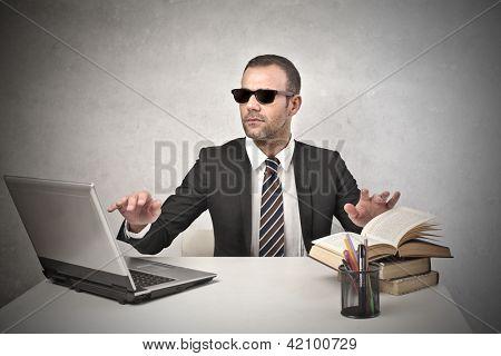 blind businessman working at his desk