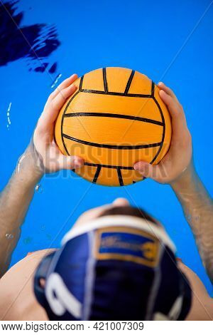 Water Polo Training. Young Sportsman Plays Water Polo In The Pool.