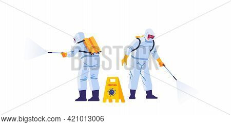Disinfecting Workers Wear Protective Masks And Spacesuits Against Pandemic Coronavirus Or Covid-19 S