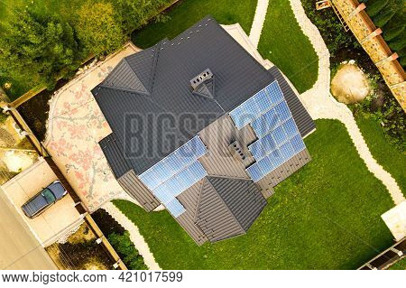 Aerial View Of A Private House With Solar Photovoltaic Panels For Producing Clean Electricity On Roo