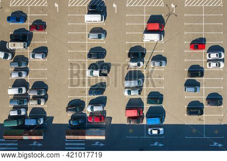Aerial View Of Many Colorful Cars Parked On Parking Lot With Lines And Markings For Parking Places A