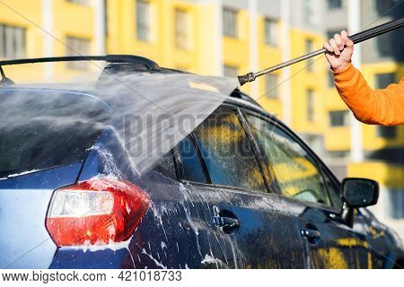 Closeup Of Male Driver Washing His Car With Contactless High Pressure Water Jet In Self Service Car