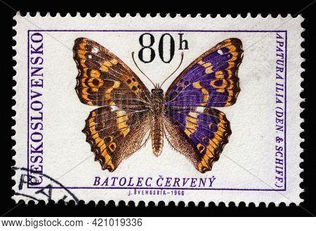 ZAGREB, CROATIA - SEPTEMBER 18, 2014: Stamp printed in Czechoslovakia shows Lesser Purple Emperor (Apatura ilia), circa 1966