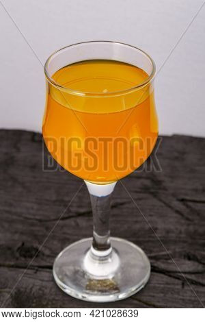Orange Juice In A Glass On A Black Background. Vertical Photo