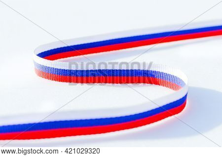 Russian Flag Tricolour, Symbol Of Russia. The Ribbon Is Painted In The Colors Of The Russian Flag. R