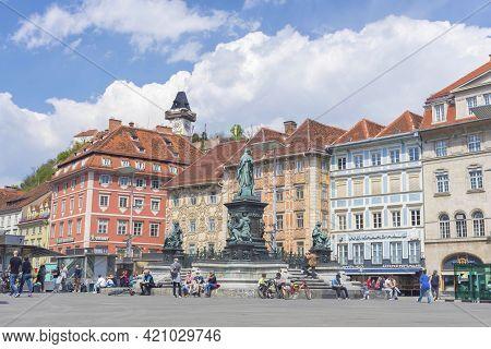 Graz, Austria-april 25, 2021: People Relaxing In Beautiful Main Square Hauptplatz, With Famous Clock