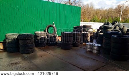 Ndustrial Landfill For Recycling Of Used Tires And Rubber Tires. A Bunch Of Old Tires And Wheels For