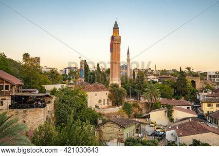 Antalya, Turkey - October 11, 2020: Historic clock tower and Yivli minaret in Kaleici old town of Antalya, Turkey