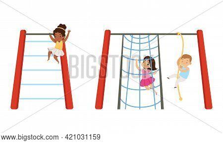 Kids Having Fun On Playground Set, Little Children Swinging On Swing And Climbing Up Rope Ladder Car