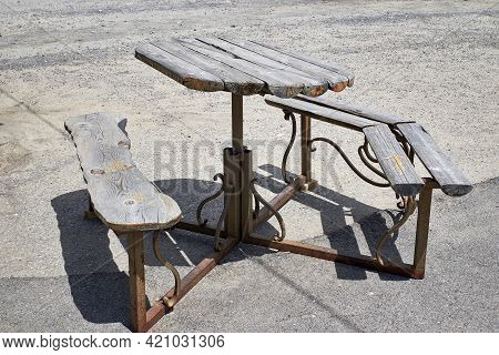 Wrought-iron Table And Chairs With Wooden Covering. An Ancient Place To Relax. Close-up