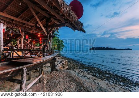 bungalow on a tropical beach after sunset