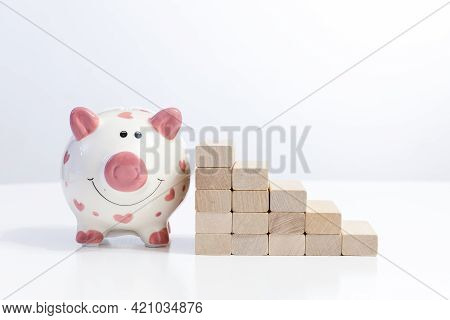 Piggy Bank And Wood Block Stacking As Step Stair Career Path Concept For Business Copy Space For Tex