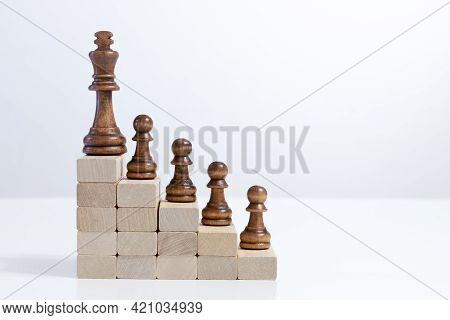 Team Leading Career For Teamwork Business Leadership Concept With Chess Figures On Top Wood Block La
