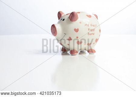 Piggy Bank On Table. Financial Saving And Save Money Concept And Copy Space