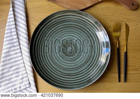 Plate On The Table. Empty Plate With Cutlery On The Table, Fork, Knife, Plate. Cutlery On The Table.