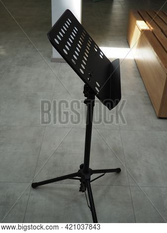 Music Stand And Bench, Beam Of Light On The Floor. A Theater, Auditorium Or Opera