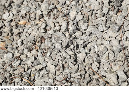 Grey Granite Chipping. Crushed Stones Background Copy Space. Macro Photo Of Crushed Rock Texture