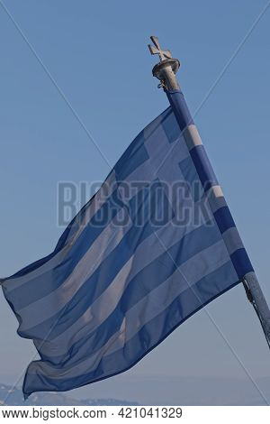 The Greek National Flag Flutters In The Wind