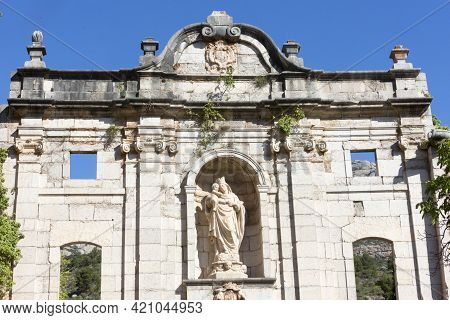 Tarragona, Spain, May 1, 2020 - Statue Of Virgin Mary With Baby Jesus On Ruins Of Old Monastery Cart