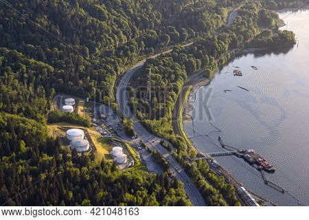 Aerial View Of Oil Refinery Industrial Site In A Modern City During A Vibrant Spring Sunny Day. Take