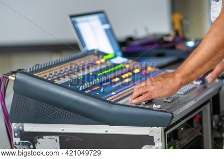 Sound engineer working at mixing panel on live. Element of design.