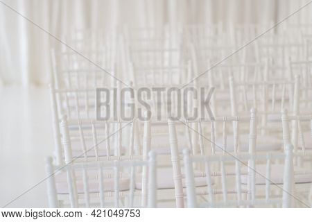 White chairs at a wedding ceremony. Element of design.