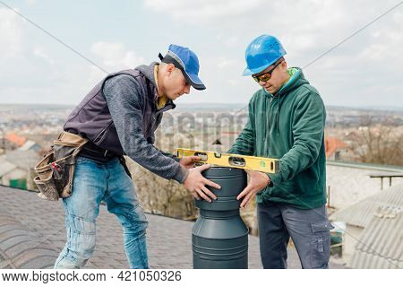 Two Professional Masters Roofer Construction Workers Repairing Chimney On Grey Slate Shingles Roof O