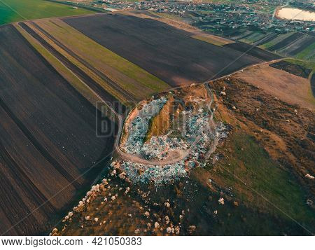 Aerial Drone View Of Large Garbage Landfill Near Agricultural Land, Trash Dump, Waste From Household