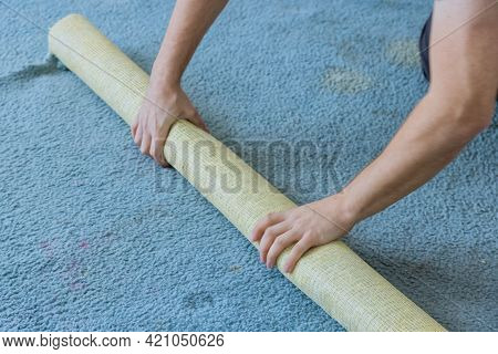 Removing A Carpet For Floor Renovation Works In The Apartment