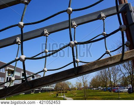 Adventure Park Playground Rope Bridge With Clear Blue Sky In The Background