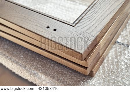 New Smooth Wooden Frames For Furniture Facades Lie On Plastic Protective Covering In Carpentry Works