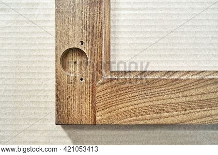 Wooden Frame For Furniture Facade With Input Hole For Hinge On Cardboard Box In Carpentry Workshop E