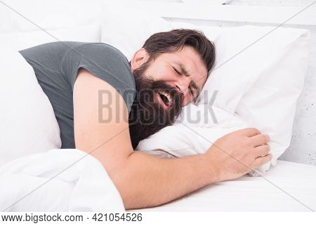 Yawning Bearded Man Feel Sleepy And Tired In Bedroom, Early Morning Wake Up