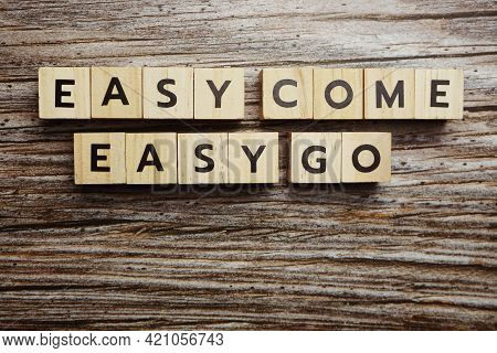 Easy Come  Easy Go Alphabet Letters On Wooden Background