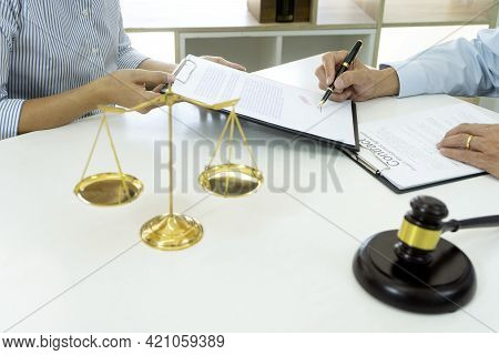 In A Law Firm, Officers Are Bringing Contract Documents Attorney