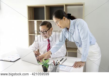 Businessman Mentor And Intern  Staff Consultant Holding Graph Paper Together