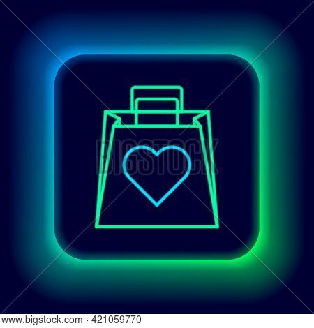 Glowing Neon Line Shopping Bag With Heart Icon Isolated On Black Background. Shopping Bag Shop Love