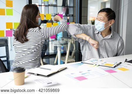 Businessman  Wearing A Mask  Say Hi To Another Covid-19