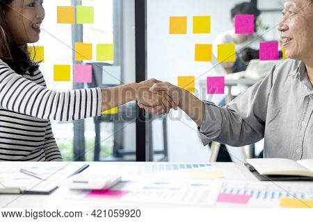 Two Smile Business People Are Shaking Hands To Congratulate