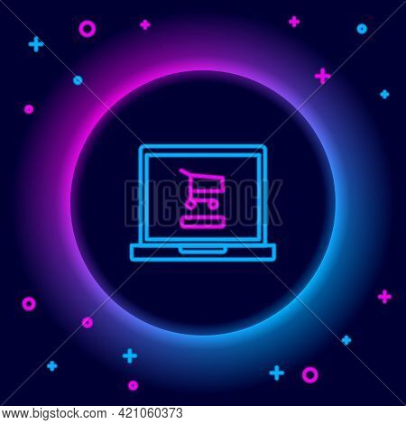Glowing Neon Line Shopping Cart On Screen Laptop Icon Isolated On Black Background. Concept E-commer
