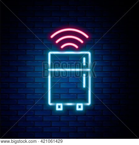 Glowing Neon Line Smart Refrigerator Icon Isolated On Brick Wall Background. Fridge Freezer Refriger