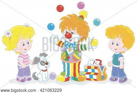 Friendly Smiling Circus Clown Showing Trick And Juggling With Colorful Balls For Little Kids And The