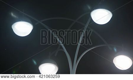 Street Lamp With Four Lamps. Stock Footage. Modern Design Of Street Lamp On Background Of Night Sky.