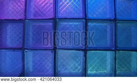 Square Glass With Neon Light. Stock Footage. Glass Wall On Background Of Flashing Colored Lights. Ne