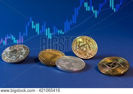 Various Cryptocurrency Coins With Bitcoin In The Centre On Blue Background. Cryptocurrency, Virtual