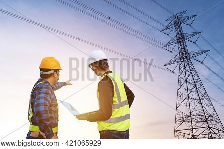 Two Electrical Engineer Standing And Watching At The Electric Power Station To View The Planning Wor