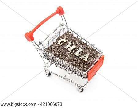 Top-side View Of A Miniature Shopping Trolley Full Of Chia Seeds And Chia Lettering Made Of Wooden L